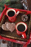 New Year mood: two cup of coffee and gingerbread in basket. New Year composition: two cup of coffee and gingerbread in basket. Top view Royalty Free Stock Photo