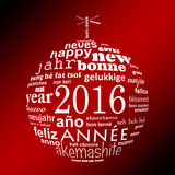 2016 new year multilingual text word cloud greeting card in the shape of a christmas ball. On red background Stock Image