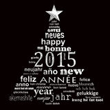 2015 new year multilingual text word cloud greeting card. In the shape of a christmas tree Stock Photo