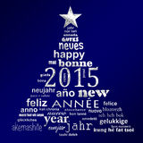 2015 new year multilingual text word cloud greeting card. In the shape of a christmas tree Royalty Free Stock Image