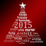 2015 new year multilingual text word cloud greeting card. In the shape of a christmas tree Stock Photography