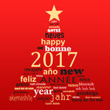 2017 new year multilingual text word cloud greeting card, shape of a christmas tree. 2017 new year multilingual text word cloud greeting card in the shape of a Royalty Free Illustration