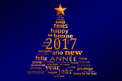 2017 new year multilingual text word cloud greeting card in the shape of a christmas tree. Blue background Royalty Free Stock Image