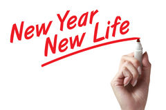 New year new life. Hand holding marker and writing new year new life royalty free stock images