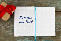 New year, new plan - text on notepad with gift.Business motivation,inspiration concepts stock photos