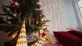 2019. New year 2019. New Year`s decor, colorful garlands, Christmas socks. Christmas tree on the Christmas tree. Interior decor. A party. Waiting for the stock video footage