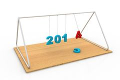 New year 2014 Newton cradle balls. In white background Royalty Free Stock Photo