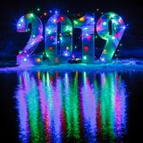 New Year 2019. The number is illuminated by a garland stock images