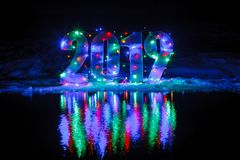 New Year 2019. The number is illuminated by a garland Royalty Free Stock Photography