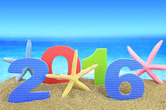New year number 2016. And starfishes on the beach Royalty Free Stock Photography