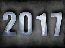 New Year numbers 2017 as ice cubes on dark dirty wall Royalty Free Stock Images