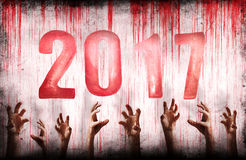 New Year numbers 2017 with bloody wall and hands Royalty Free Stock Images