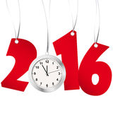New year 2016 numbers and clock. Red numbers showing New Year 2016 with silver clock Royalty Free Stock Image