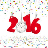New year 2016 numbers and clock. Red numbers showing New Year 2016 with silver clock and confetti background Stock Photo