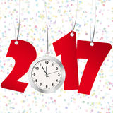 New year 2017 numbers and clock. Red numbers showing New Year 2017 with silver clock and confetti background Royalty Free Stock Photo