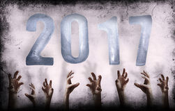 New Year numbers 2017 and grungy wall with hands Stock Photo