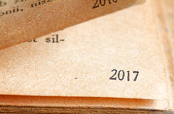 2017 new year numbers on the page of book background concept Stock Photo