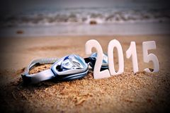 2015 New Year numbers on the sea beach. Background and Texture for text or image Royalty Free Stock Photo