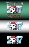 New Year numbers 2017 and soccer ball. Set snowy New Year numbers 2017 and soccer ball in a Christmas hat with football boots on the background of the gate Royalty Free Stock Photo