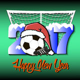 New Year numbers 2017 and soccer ball. Snowy New Year numbers 2017 and soccer ball in a Christmas hat with football boots on the background of the gate. Vector Stock Image