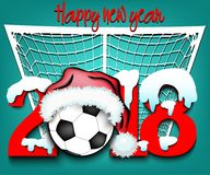 New Year numbers 2018 and soccer ball. Snowy New Year numbers 2018 and soccer ball in a Christmas hat with football boots on the background of the gate. Vector Royalty Free Stock Images
