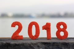 New year numeral thread. figures stand on a concrete fence. New year numeral thread. the background of the sky, the river. figures stand on a concrete fence Royalty Free Stock Photo