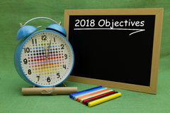 2018 New Year objectives. 2018 New Year objectives written on a small blackboard Royalty Free Stock Photo