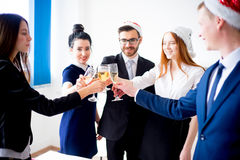 New year office party. Businessmen celebrating new year at office party Stock Photo