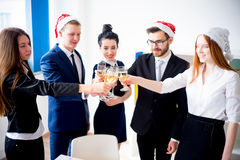 New year office party. Businessmen celebrating new year at office party Stock Images