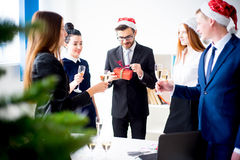 New year office party. Businessmen celebrating new year at office party Royalty Free Stock Photography