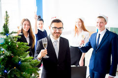 New year office party. Businessmen celebrating new year at office party Royalty Free Stock Images