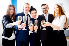 New year office party. Businessmen celebrating new year at office party Royalty Free Stock Image
