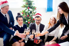 New year office party. Businessmen celebrating new year at office party Stock Image