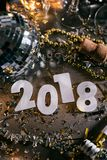 New Year: Overhead View Of 2018 Numbers For NYE. A series celebrating New Year`s Eve, some with 2018 numerals.  Lots of confetti, champagne, etc. Good for Stock Photos