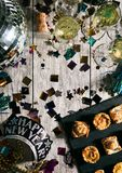 New Year: Overhead View Of Table With Appetizers And NYE Crown. A series celebrating New Year`s Eve, some with 2018 numerals.  Lots of confetti, champagne, etc Royalty Free Stock Image