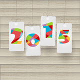 New Year 2015 on paper Cut. On wood background Stock Illustration