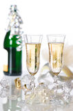 New Year Party. Celebration with champagne glasses and bottle in background covered in tinsel Royalty Free Stock Photos