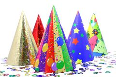 New Year/Party. Five party hats and confetti Stock Image