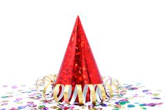 New Year/Party. Red part hat, confetti and gold streamer Stock Photography