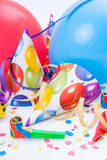 New Year party, celebration or festivity. With party hats, horns, whistles or noisemakers, balloons, confetti and streamers Stock Images