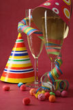 New year party and champagne. New year party with glasses of champagne and accessories Royalty Free Stock Image