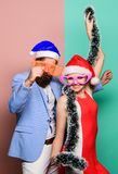 New year party. Family celebrating christmas. happy couple in santa claus hat. Merry christmas and happy new year. Christmas shopping. gifts. The best present royalty free stock image