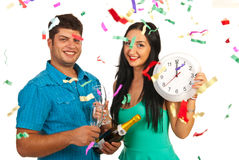 New year party. Happy couple celebrate new year party with champagne and confetti Stock Photos