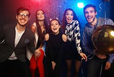 New year party, holidays, celebration, nightlife and people concept - Young people having fun dancing at a party.  royalty free stock photography