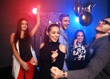 New year party, holidays, celebration, nightlife and people concept - Young people having fun dancing at a party royalty free stock photos