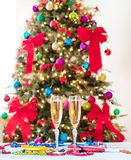 New Year party objects with Christmas tree in background. New Year party objects with Christmas tree Stock Photo