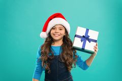 New year party. Santa claus kid. Little girl child in santa hat. Present for Xmas. Childhood. Happy winter holidays. Small girl. Christmas shopping. For Santa stock photos
