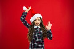 New year party. Santa claus kid. Little girl child in santa red hat. Present for Xmas. Childhood. Happy winter holidays. Small surprised girl. Christmas stock images