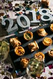 New Year: Party Snacks With Champagne And Metal 2018 Royalty Free Stock Photos