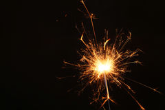 New year party sparkler on black background. Royalty Free Stock Image